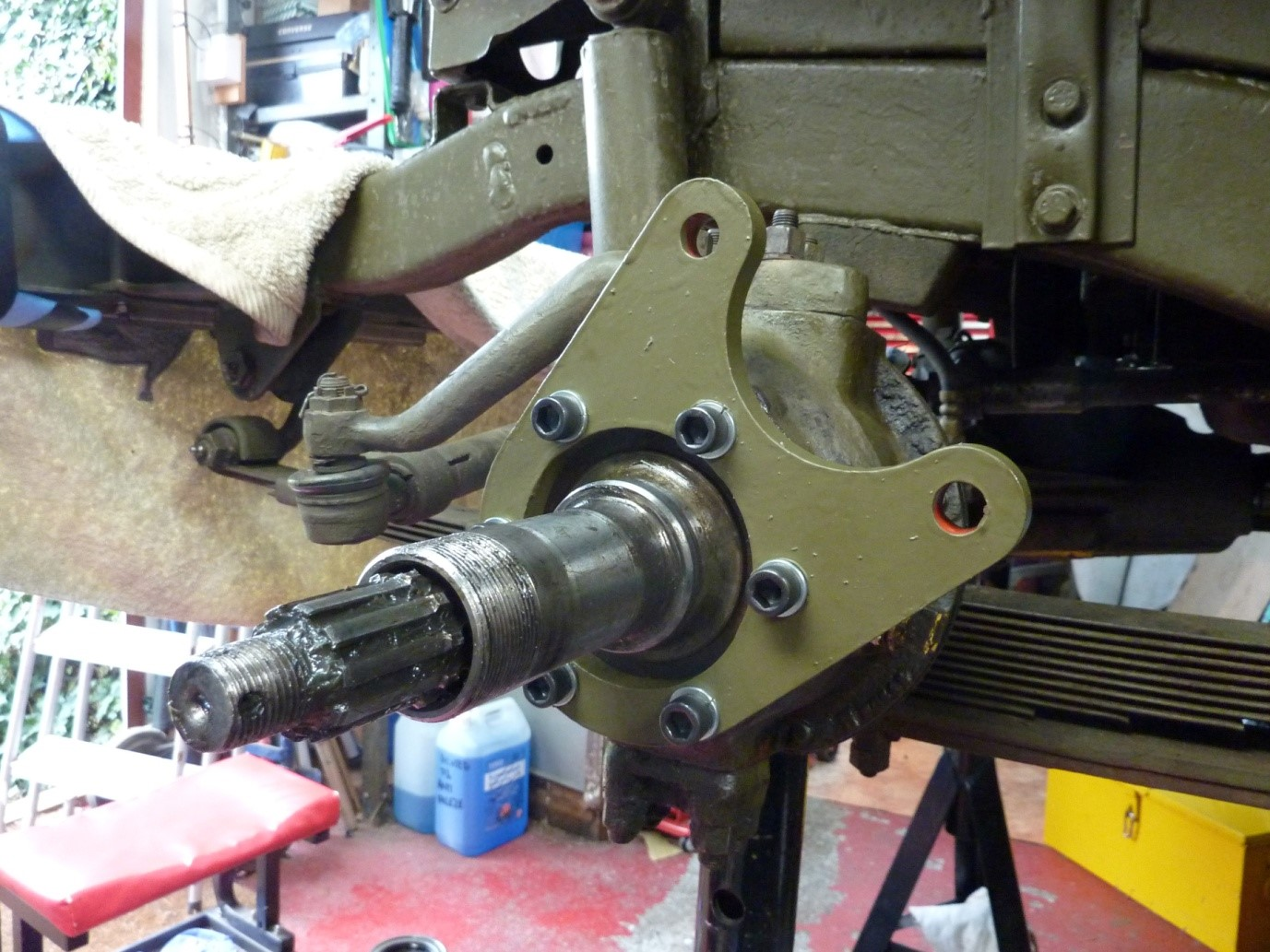 Bracket fitted at about one thirty position. This way the calliper doesn't obstruct access to the knuckle grease plug