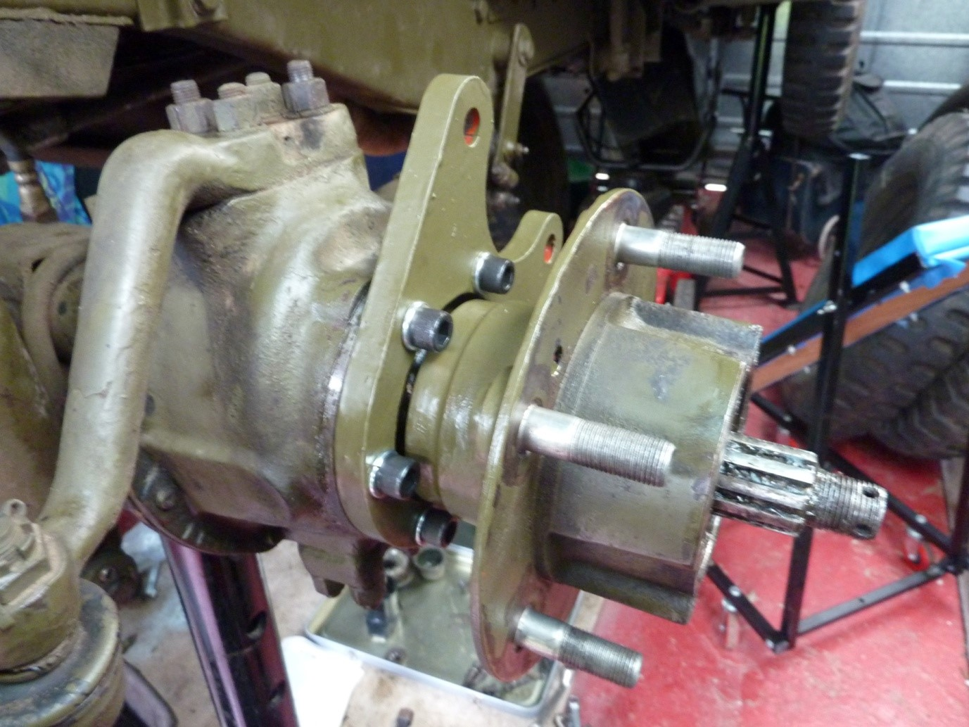 Hub mounted with drum removed and new Dorman lugs pressed into place