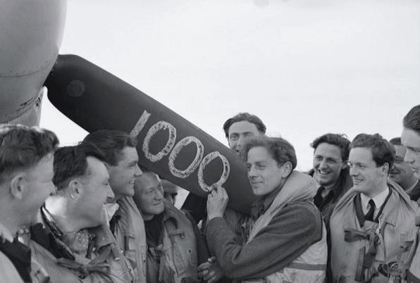 Squadro Leader Jack Charles and fellow Biggin Hill pilots mark the 1,000 kill for the station.