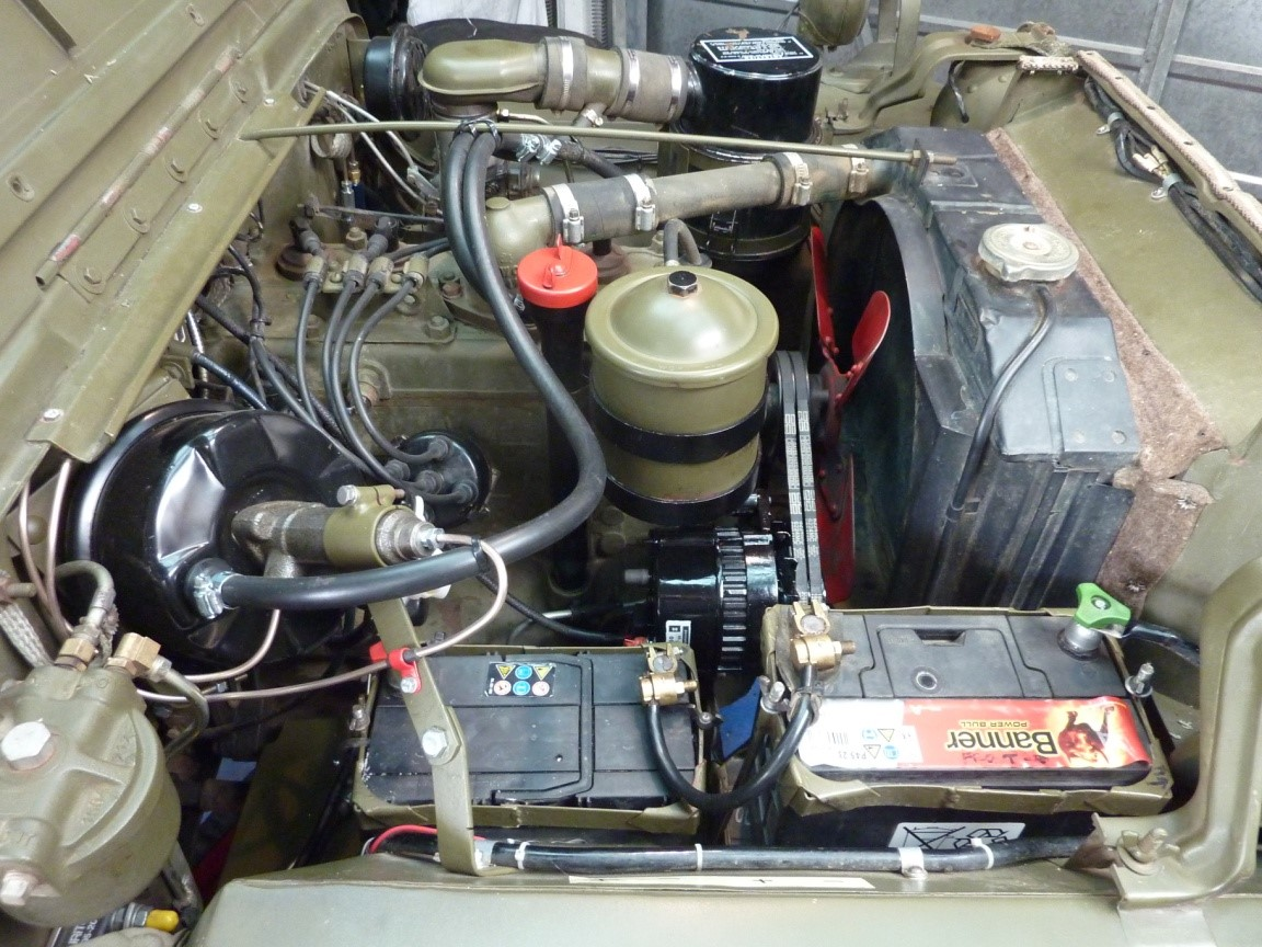 My engine compartment after the project. The booster and 24V alternator (now painted black) don't look too out of place amongst all the other engine ancillaries.